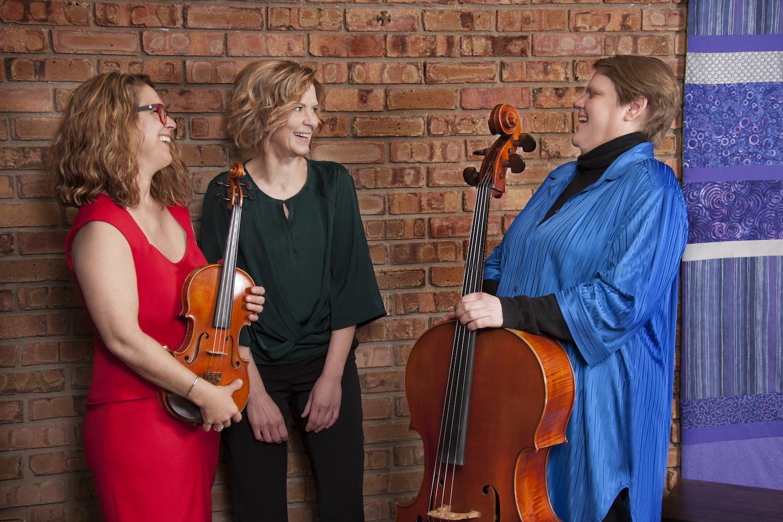 Violinist  Daryl Silberman  (left), Pianist  Sandra Carey  (middle), Cellist  Cathy Kuna  (right).