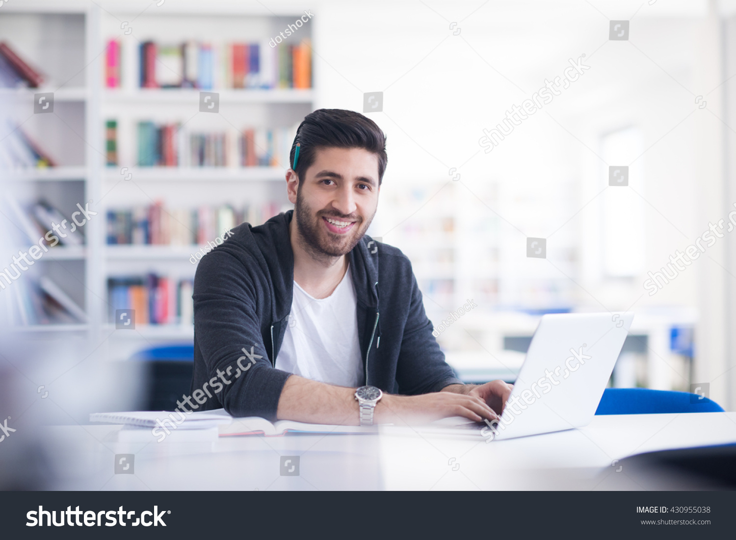 stock-photo-student-preparing-exam-and-learning-lessons-in-school-library-making-research-on-laptop-and-browse-430955038.jpg