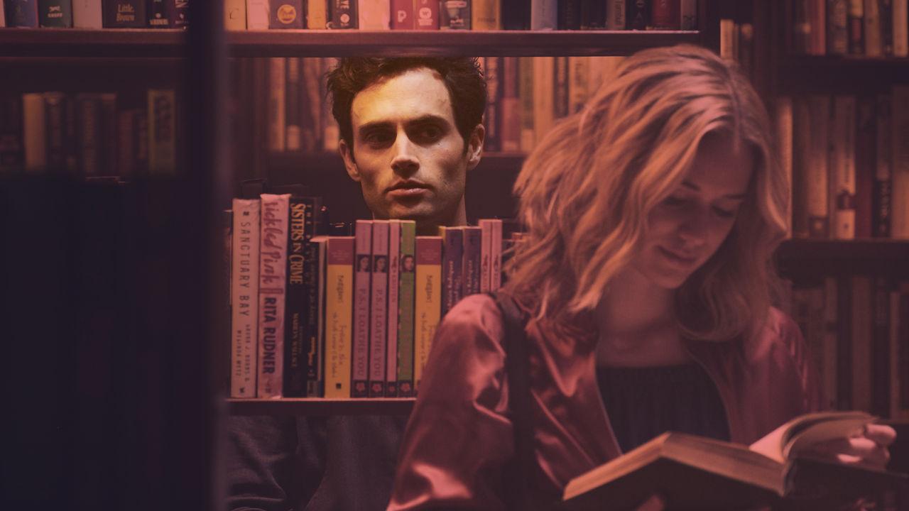Penn Badgley and Elizabeth Lail in Netflix's YOU // Image via Netflix.