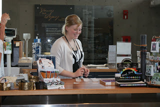 Lara, front desk attendant, organizing items at the front desk.