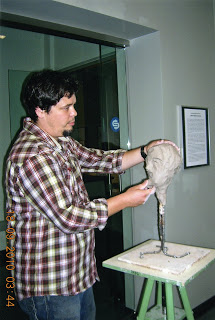 Troy Nickle demonstrating clay sculpture, Art Walk 2010