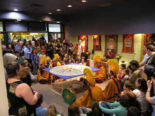 The closing ceremonies of the Tibetan Monk tour, where they swept up the sand mandala and gave some to everyone in the audience