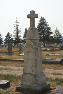 Look carefully at the base of this next headstone. When we started working on this monument, the base was buried up to the top of the stone along the front side. Because the monument was leaning, gravity was enough for the top of the cross to break off (you can see the line). The monument was leveled (with copious amounts of gravel and sand placed under it) and the cross re-attached.