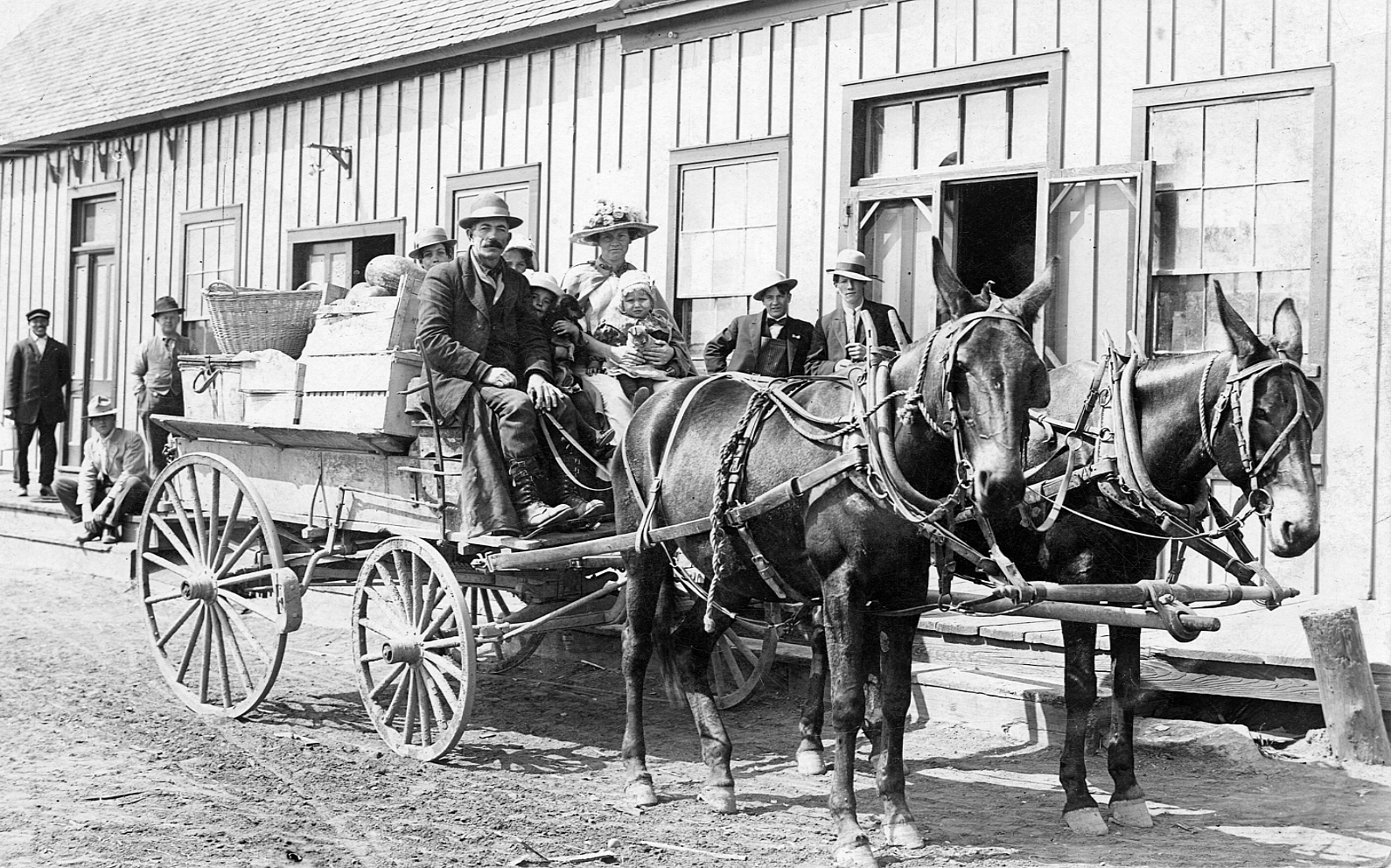 James Dodge family shortly after arriving in Lethbridge in front of the train station. 1913. Galt Archives 19841022000