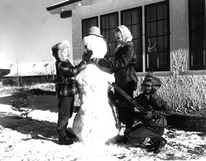 Image of School Children Making a Snowman – 16 Nov 1952   Photo courtesy the Galt Museum & Archives: 19752911006