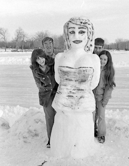 A feminist response to the snowman tradition by Diane and Ted Buzunis (left) and Linda and Randy Coyle on the shore of Henderson Lake, 1971.   Photo courtesy the Galt Museum & Archives: 1991107615659