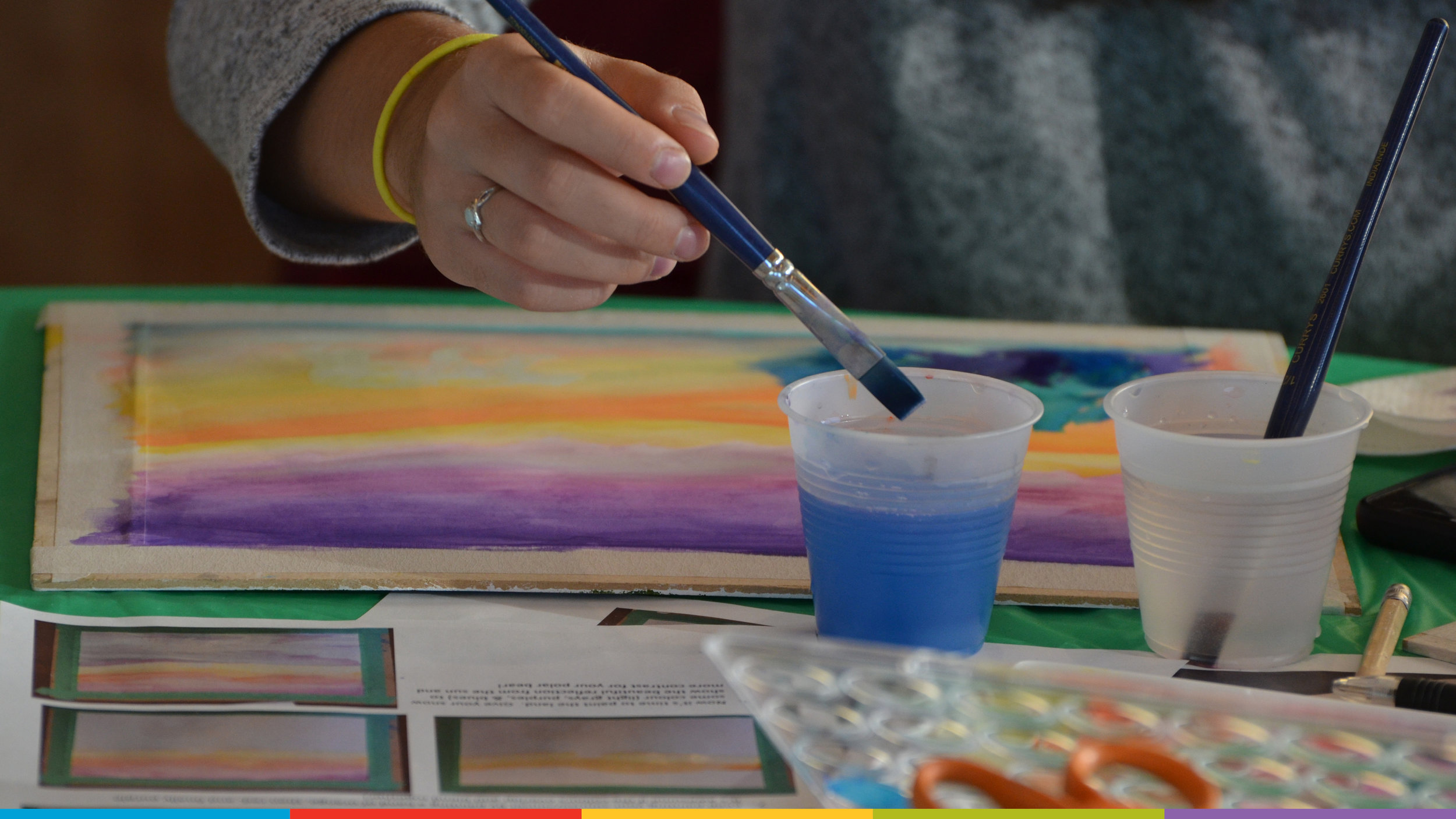 A photo of a paintbrush and a watercolour painting.