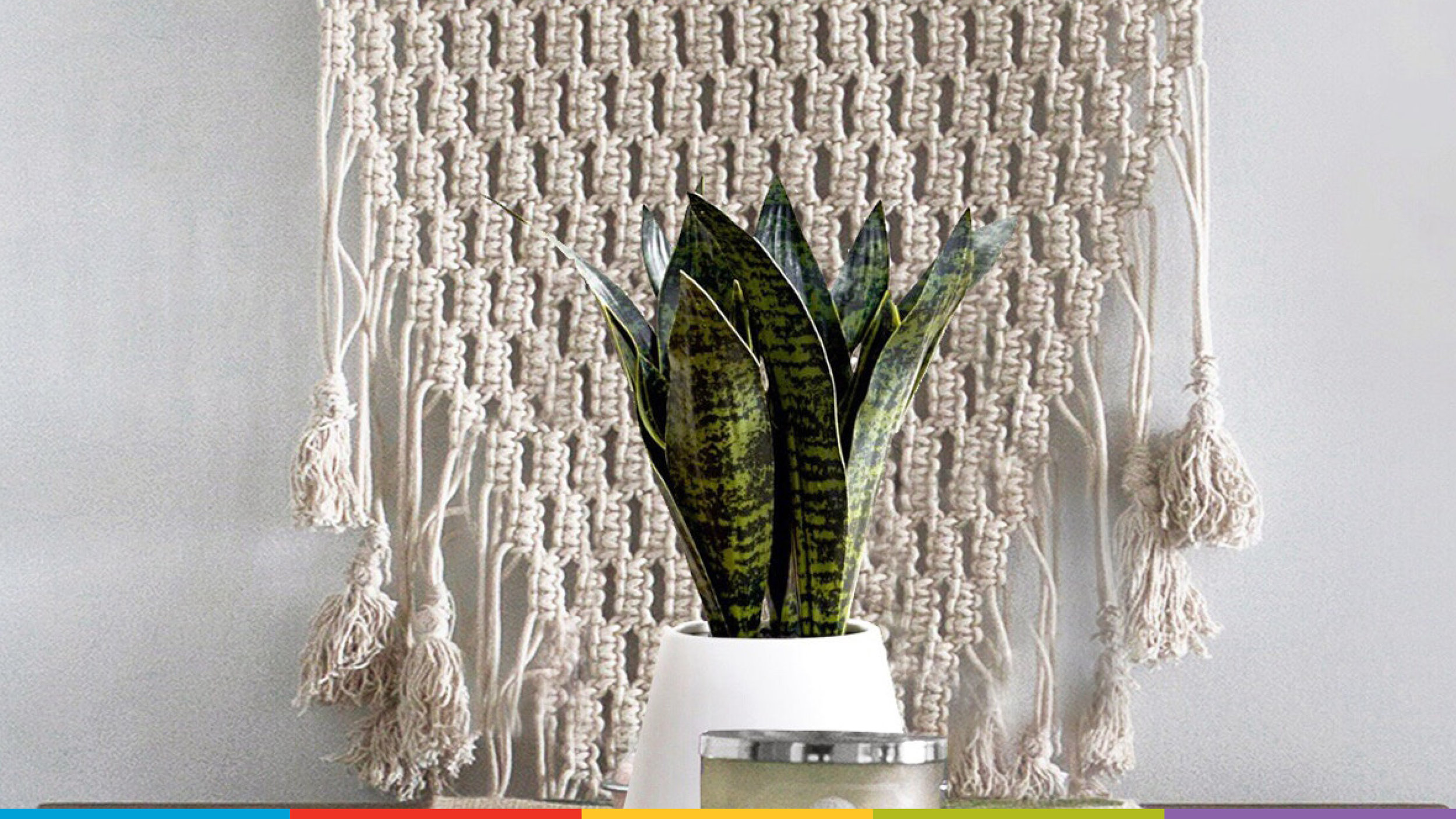 A wall hanging with a plant in the foreground.  Photo from Designecologist on Unsplash