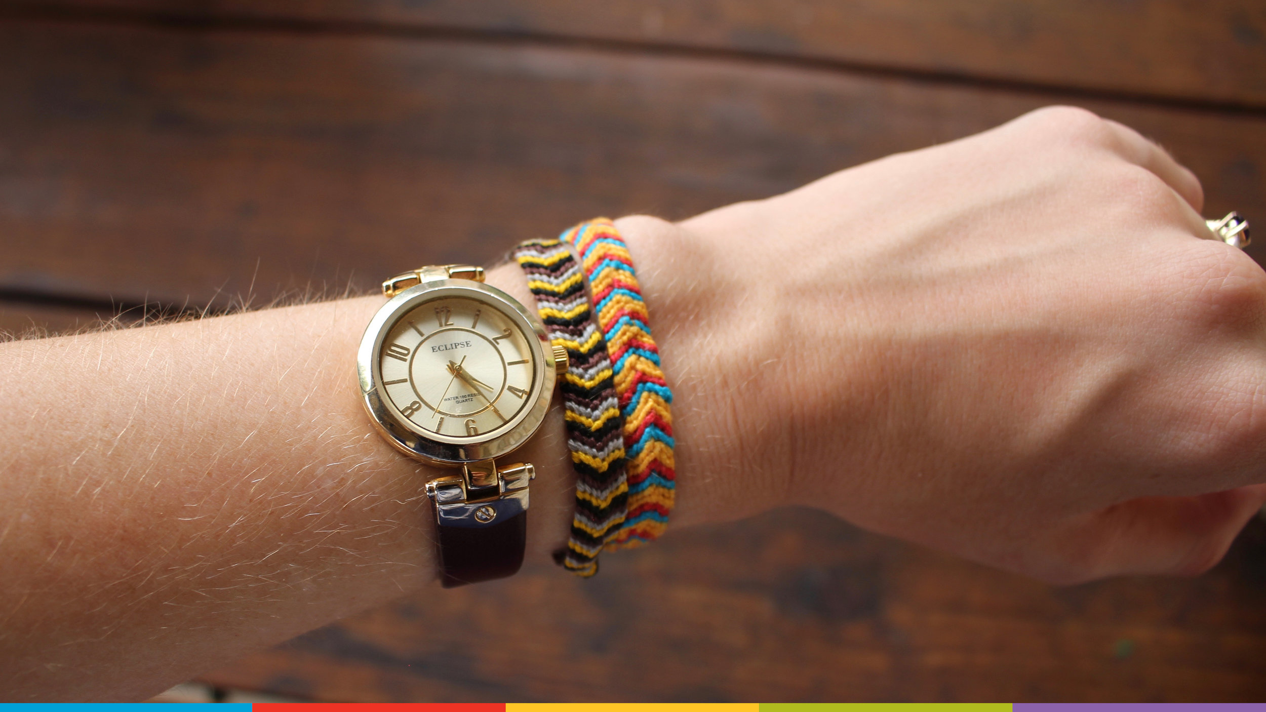 A photo of a wrist with two bracelets and a watch.  Photo from Christy Ash on Unsplash