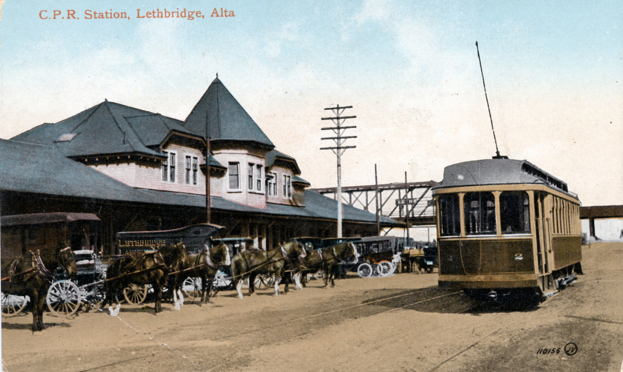 A streetcar, horse and wagons, and automobiles in front of the Canadian Pacific Railway (CPR) station on 1 Avenue South Lethbridge in 1915.