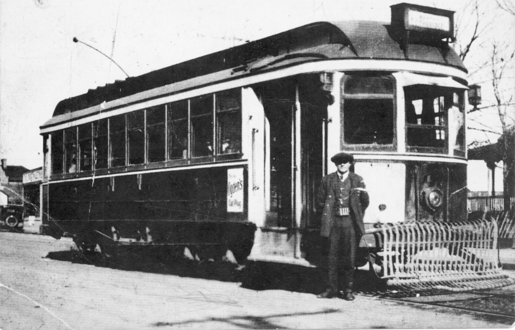 James Lawrence Davis in front of a Lethbridge streetcar.    Courtesy  Galt Museum & Archives: P19901009001