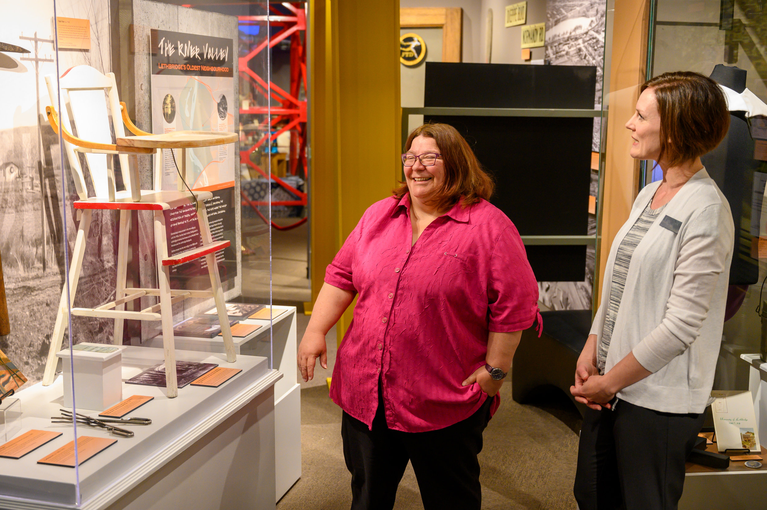 Curator Aimee Benoit and Lethbridge Historical Society President Belinda Crowson examining a display in the exhibit.