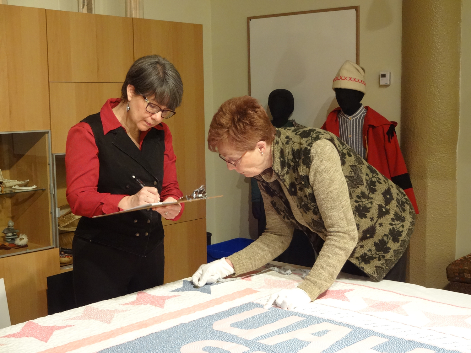 Lucie Heins  (left) and volunteer Diane Bretton at the Musée Héritage Museum in St. Albert at a recent documentation event. Photo by Shari Strachan.