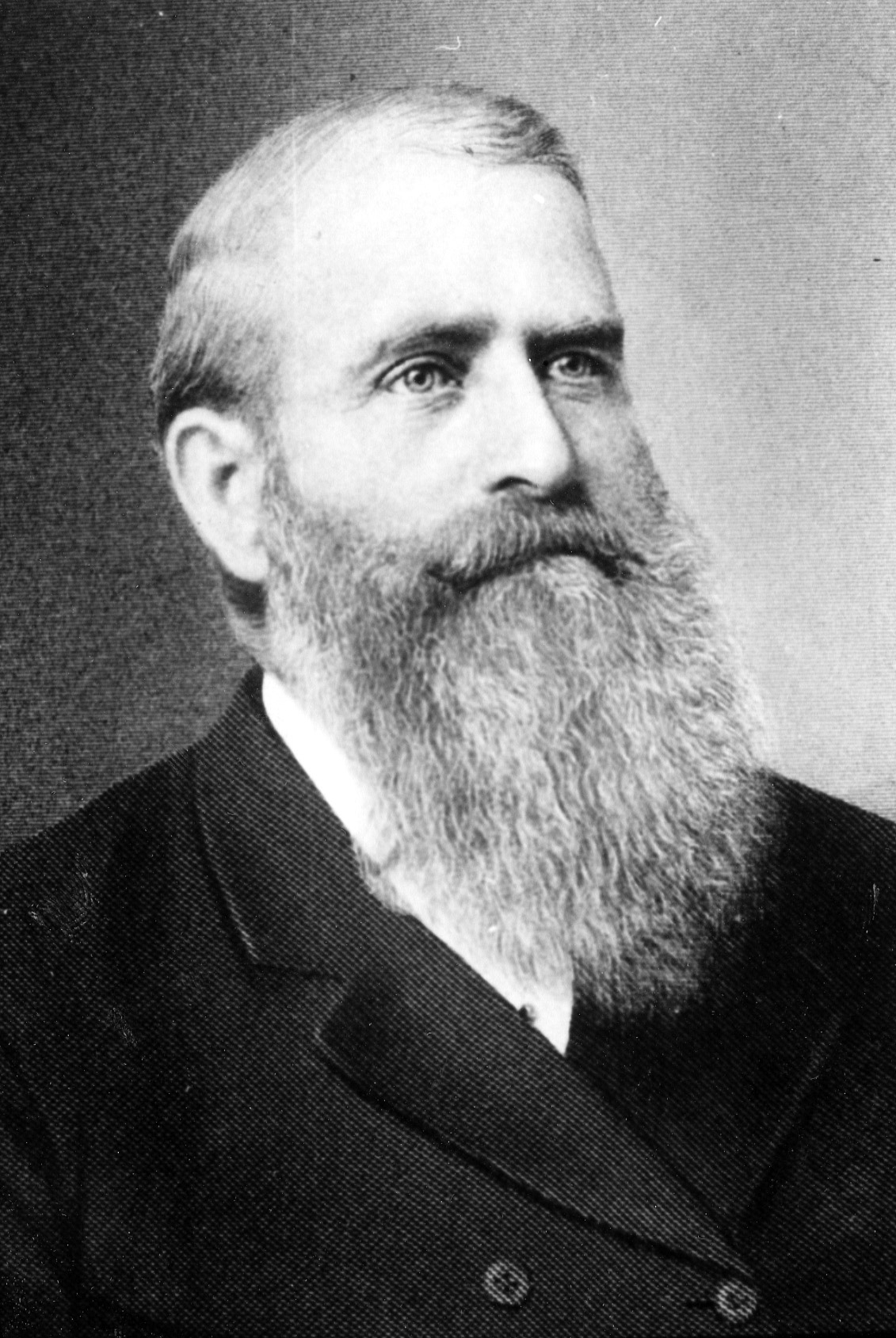Head and shoulders portrait of colonizer and regional Mormon leader, Charles Ora Card, likely taken in the 1880s.  Photo courtesy the Galt Museum & Archives,  19851055000 .