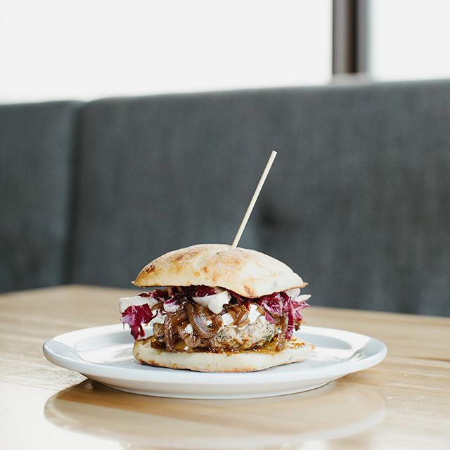 Carbone Cafe Club's @leburgerweek's official entry: Jam-Packed Ricotta Burger 🤤  We are packing the local support between these 2 buns! Manitoba raised hand pressed turkey burger with herb ricotta, fig jam (YUM), carmelized balsamic onions and vinaigrette-dressed radicchio all jamming out on a ciabatta bun. Only available at @carbonecafeclub 260 St. Mary Ave. ✌️ . #supportlocal #carbonecafeclub #carbonerestaurants #getcreative #manitibamade #burgerweek #leburgerweek #nomnom
