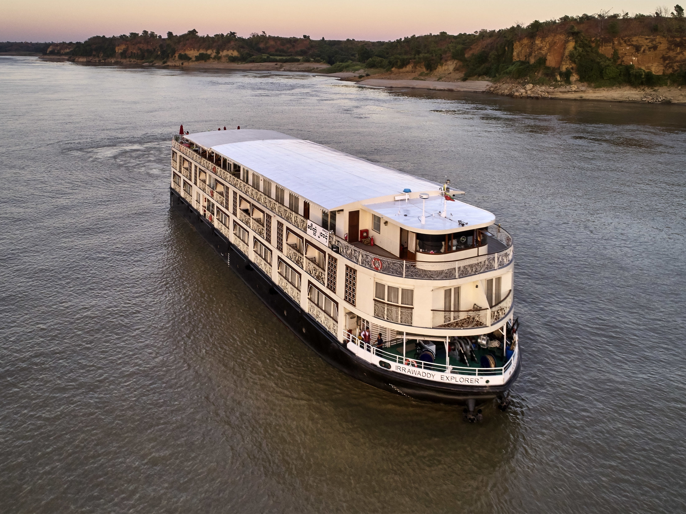 Irrawaddy Explorer - The sleek Irrawaddy Explorer is the newest and most luxurious of the fleet. Even before it leaves the dock, it takes you into another world of colonial elegance. With its beautiful art nouveau stairway, old-style furniture, gleaming hardwood floors, potted plants and classic light fixtures, it oozes colonial charm. This theme is carried into the whole interior of the ship, including the 28 luxurious suites, the Writers' Lounge, the Custom House dining room, the Spa Room and the Fitness Centre. The 28 luxury suites are named Mandalay, Kipling, Orwell and Maugham, all with floor-to-ceiling glass doors to enjoy the magnificent views of the Irrawaddy River. Each suite comes with its own artwork. For the duration of the cruise, live in another time and place while enjoying modern conveniences.