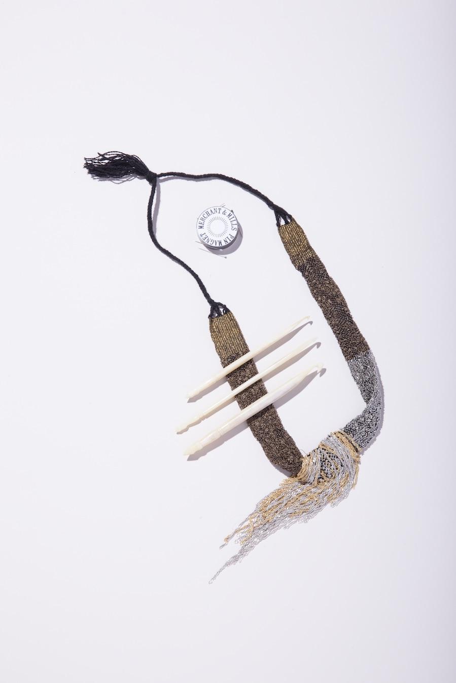 Jess Feury  Beaded Necklace;  Fringe Supply Co  Bone Crochet Hooks;  Merchant & Mills  Pin Magnet.
