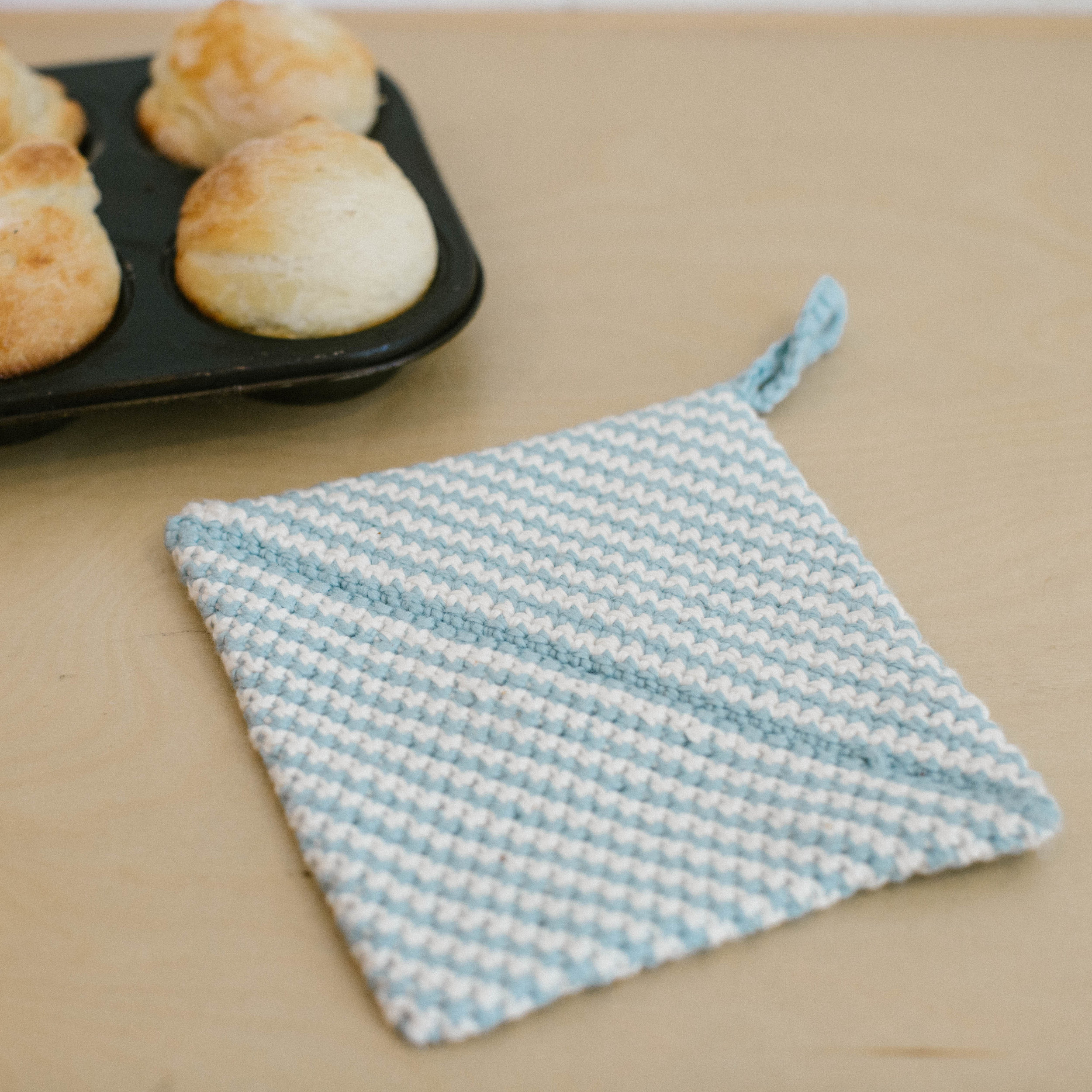 """Cattywampus Craft's """"Origami Potholder"""" - How cute and clever is that diagonal seam, though? Our personal favorite reason for a road trip to Ojai have something for the crocheters and the bakers alike!"""