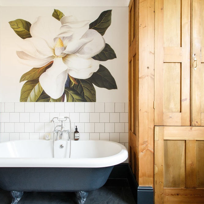 A Simple Bathroom Gets a Lift From Warm Wood and a Flower Mural - Traditional style and modern functionality combine to create a bathroom that's both cozy and elegant
