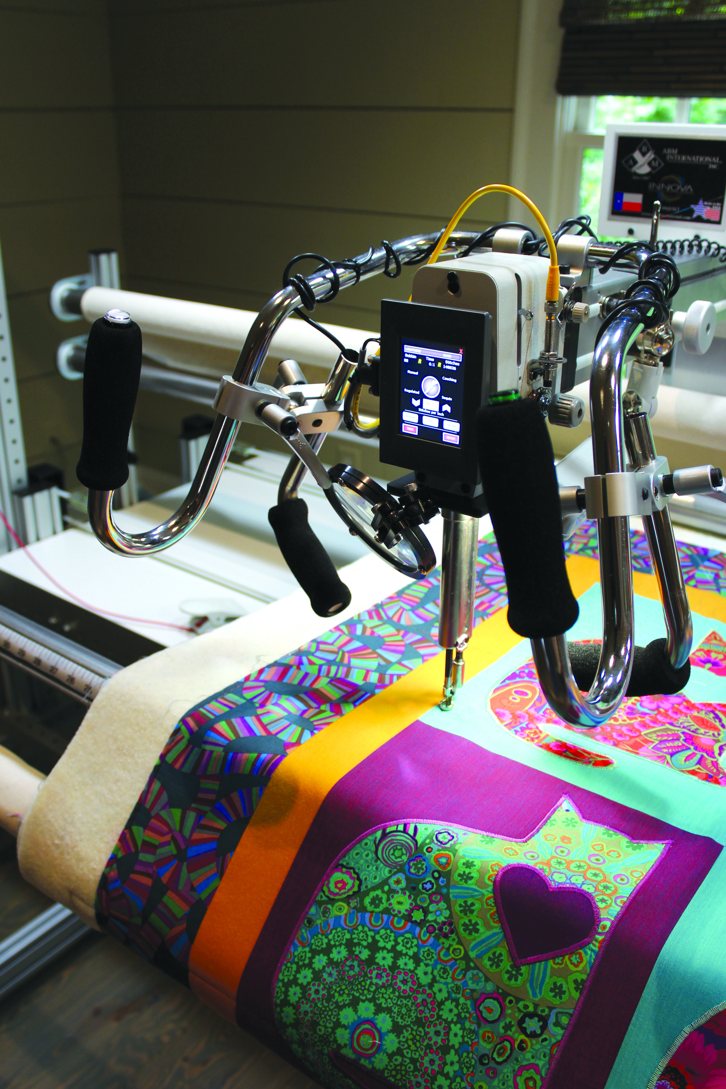 Janice uses her two Bernina domestic sewing machines and an INNOVA longer machine to create quilts.