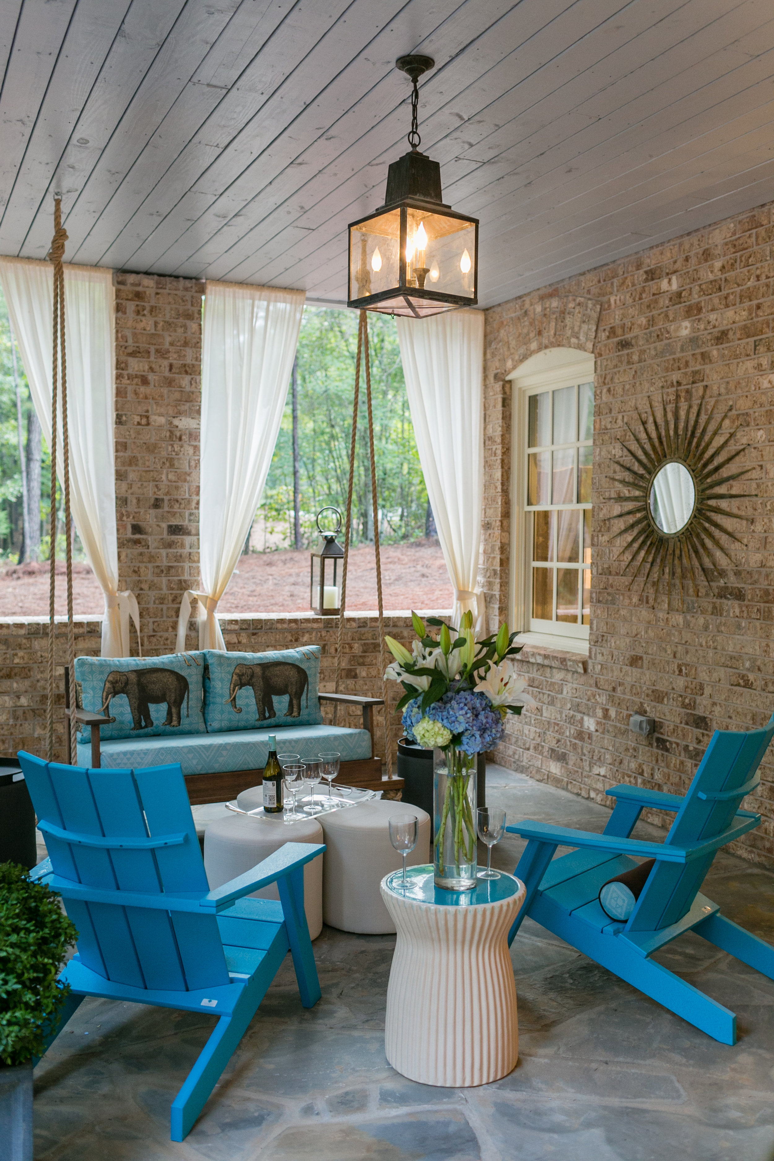 2015 Showhouse Outdoor Terrace by Stuart Pliner Design offered a gorgeous and cozy place to relax while looking out onto woods and Grange Lake.  Photo by    J. Ashley Photography   .
