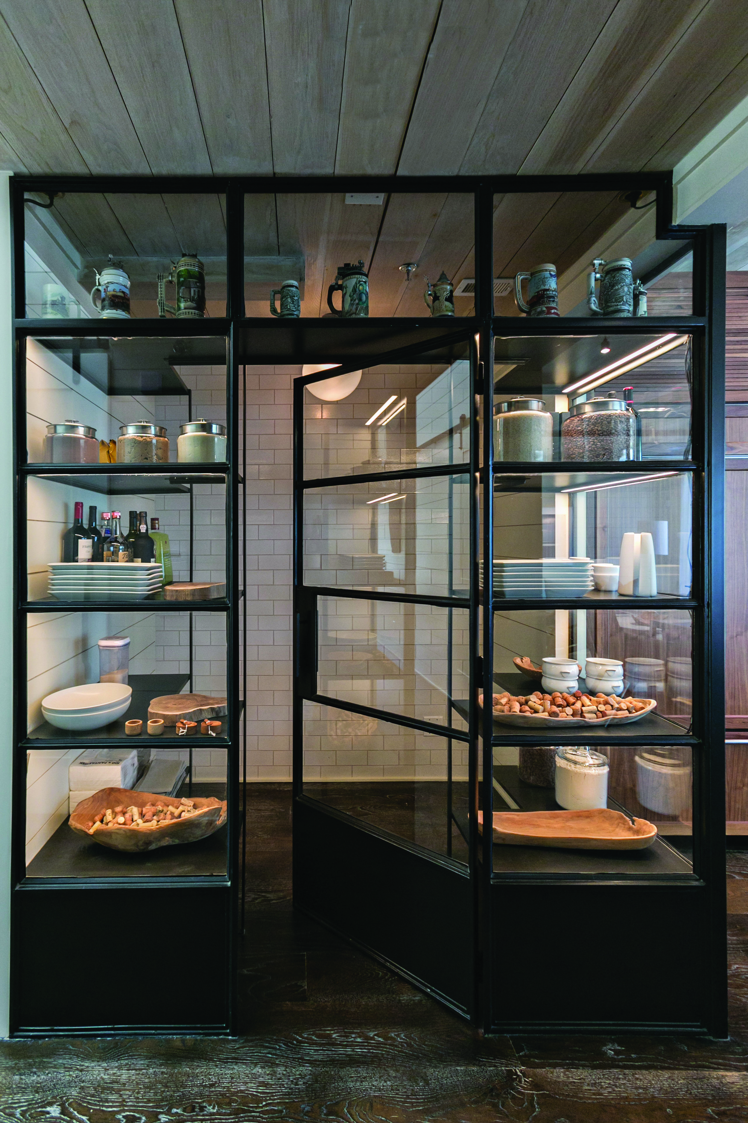 Custom kitchen pantry made of steel and glass walls. Photo by    J. Ashley Photography   .