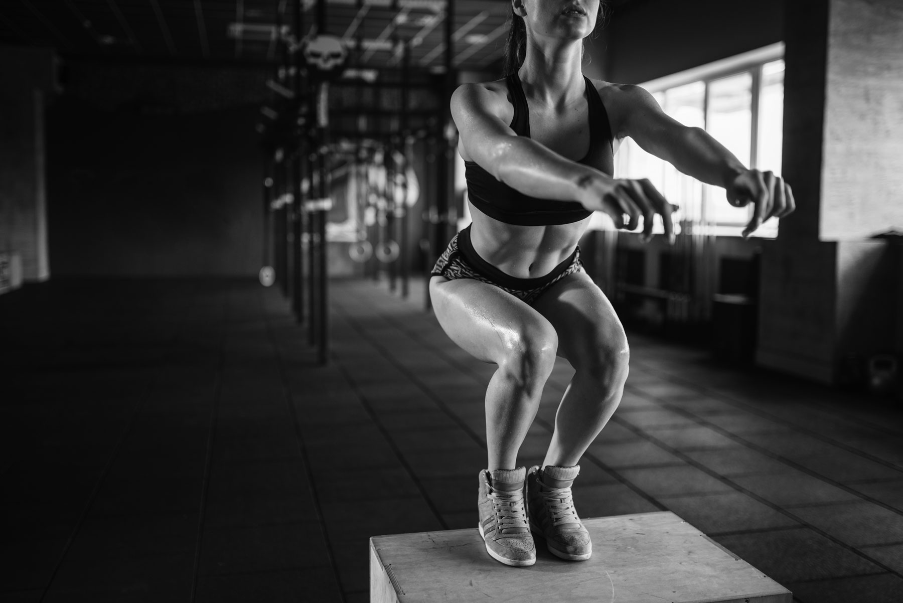 woman-doing-box-jump-exercise-in-fitness-club-PWECQ9X.jpg