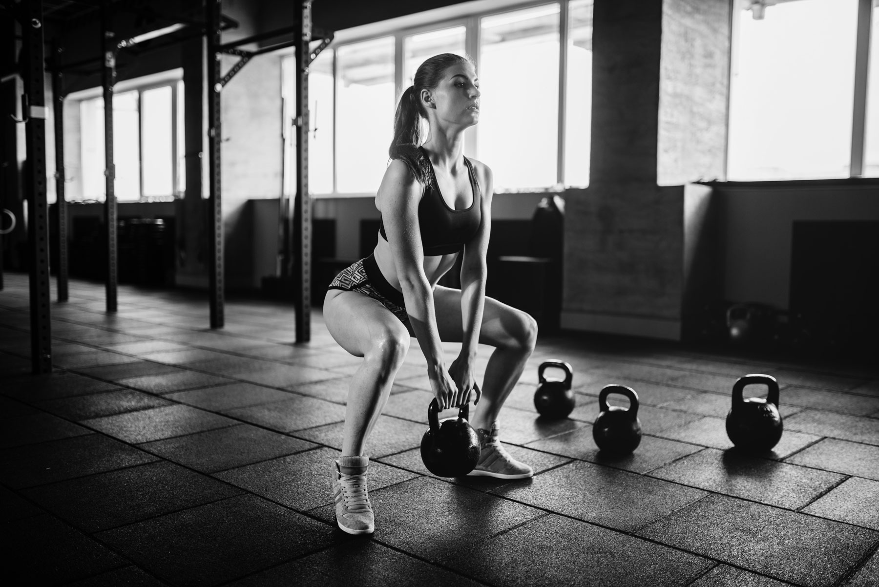 woman-doing-exercise-with-weight-in-fitness-club-PUPN3C8.jpg