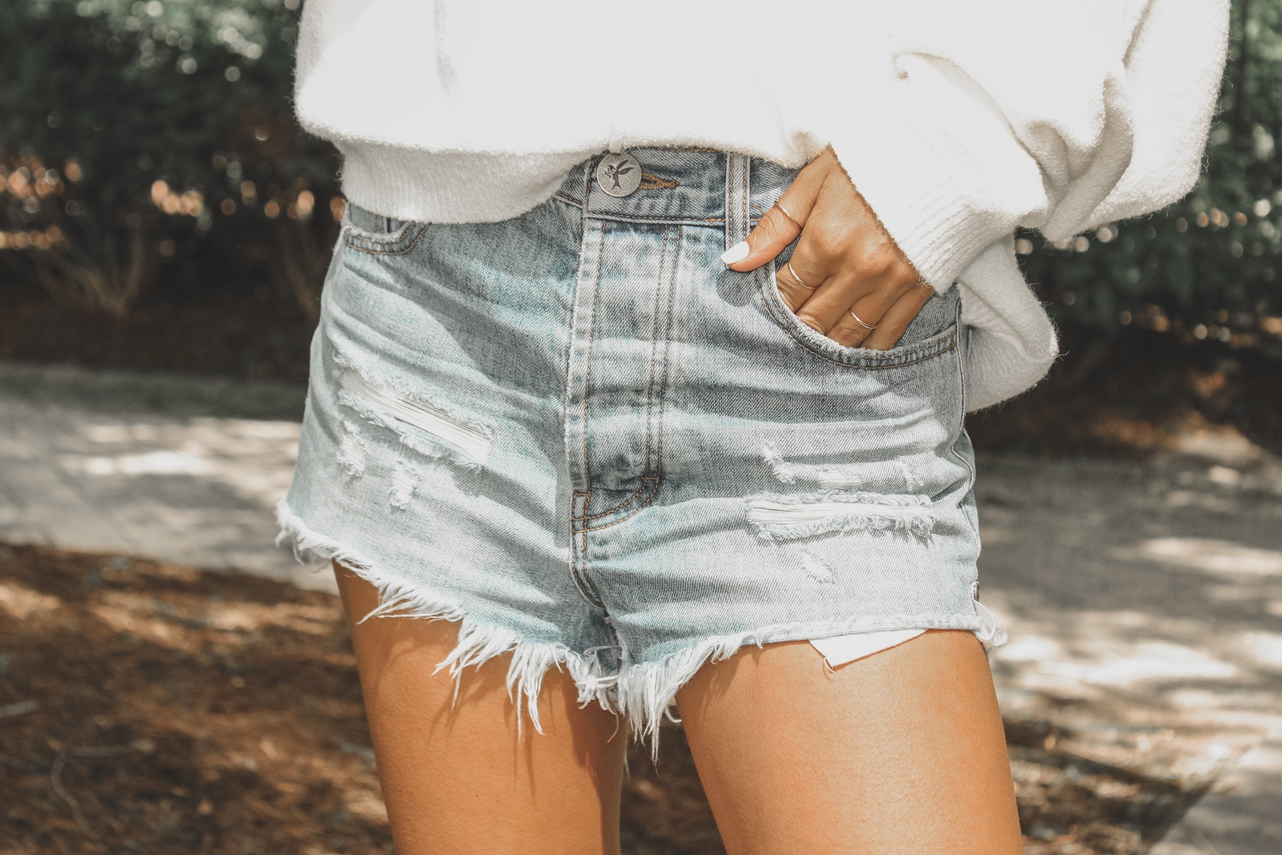 Outlaws Shorts -  shopbop  // Take Me Places Pullover -  Free People  // 14K Gold Rings -  Glamrocks Jewelry
