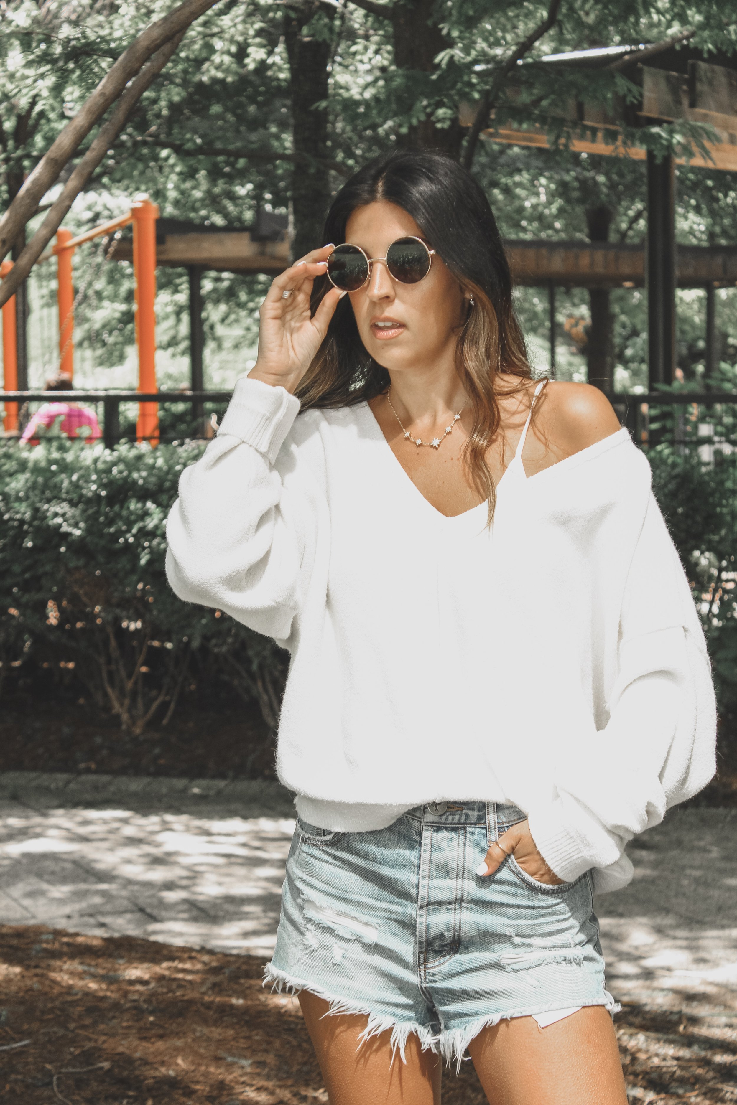 Outlaws Shorts -  shopbop  // Take Me Places Pullover -  Free People  // Sunnies -  Forever21  // (similar) Floral Booties -  Sam Edelman  // 14K Gold Rings -  Glamrocks Jewelry