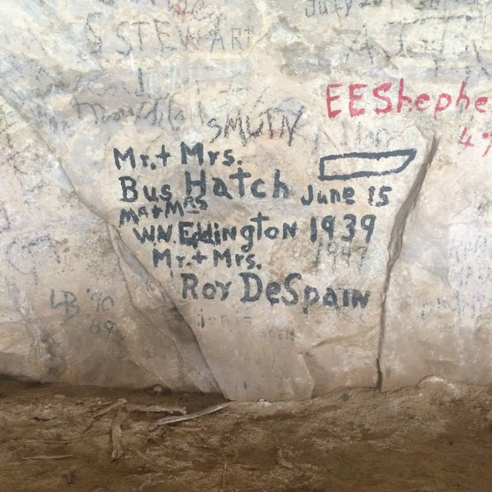 Bus Hatch inscription alongside those of other historic river runners in Signature Cave on the Yampa River. Photo: Sara Porterfield