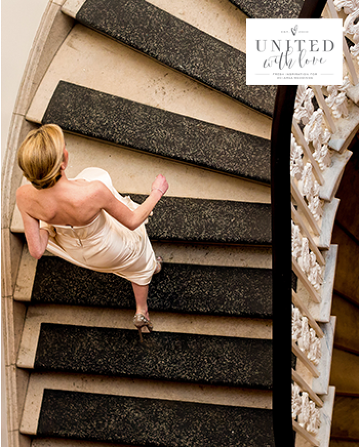 woman in white ascending a staircase - magazine cover