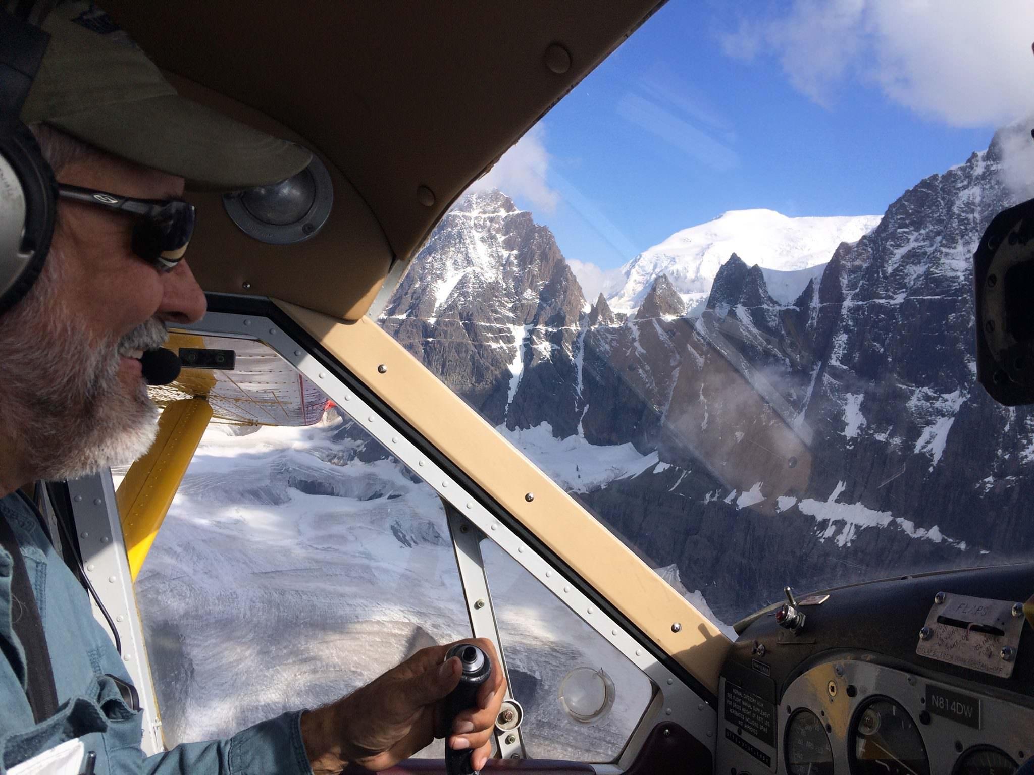 Wrangell Mountain Air founder, Kelly Bay flies the DeHavilland Beaver around Castle Peak.