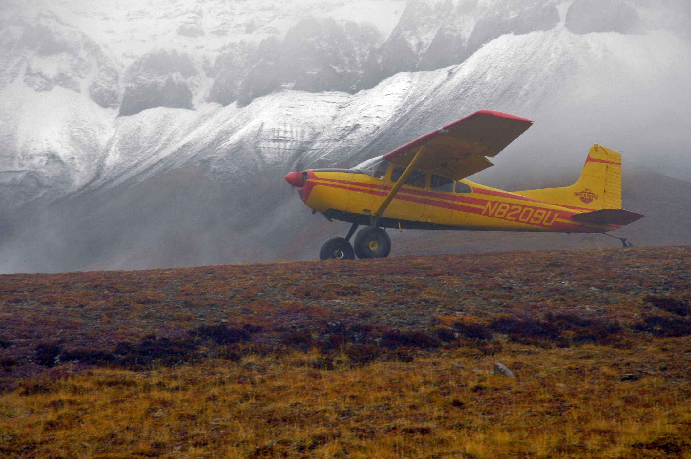 185 at Wolverine airstrip for backcountry backpacking drop-off with snow.jpg