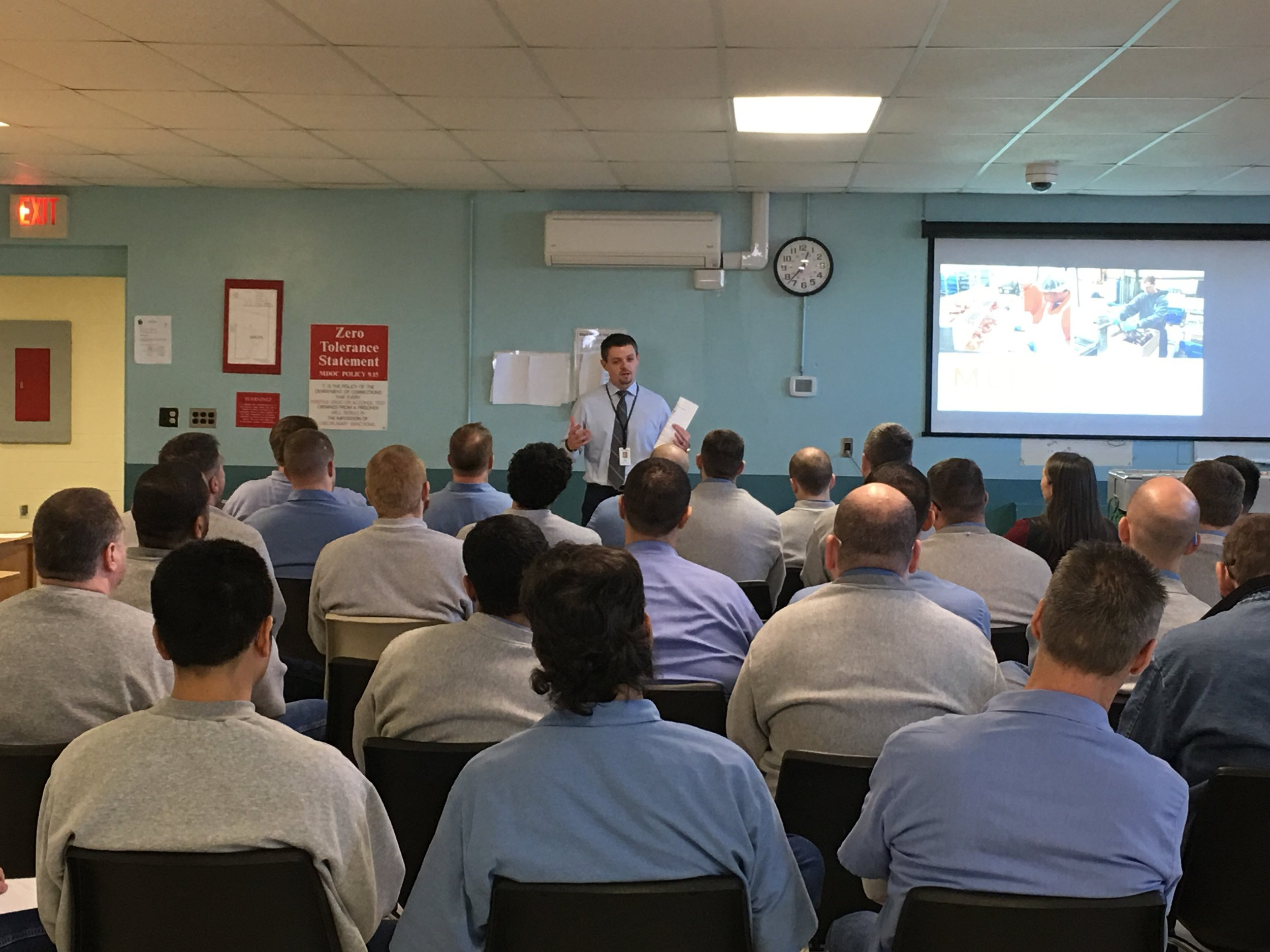 Maine Department of Corrections Deputy Commissioner Ryan Thornell welcomes a group of offenders on December 7 at the introductory training session. Photo by Madelyn Kearns for Seafood Source.