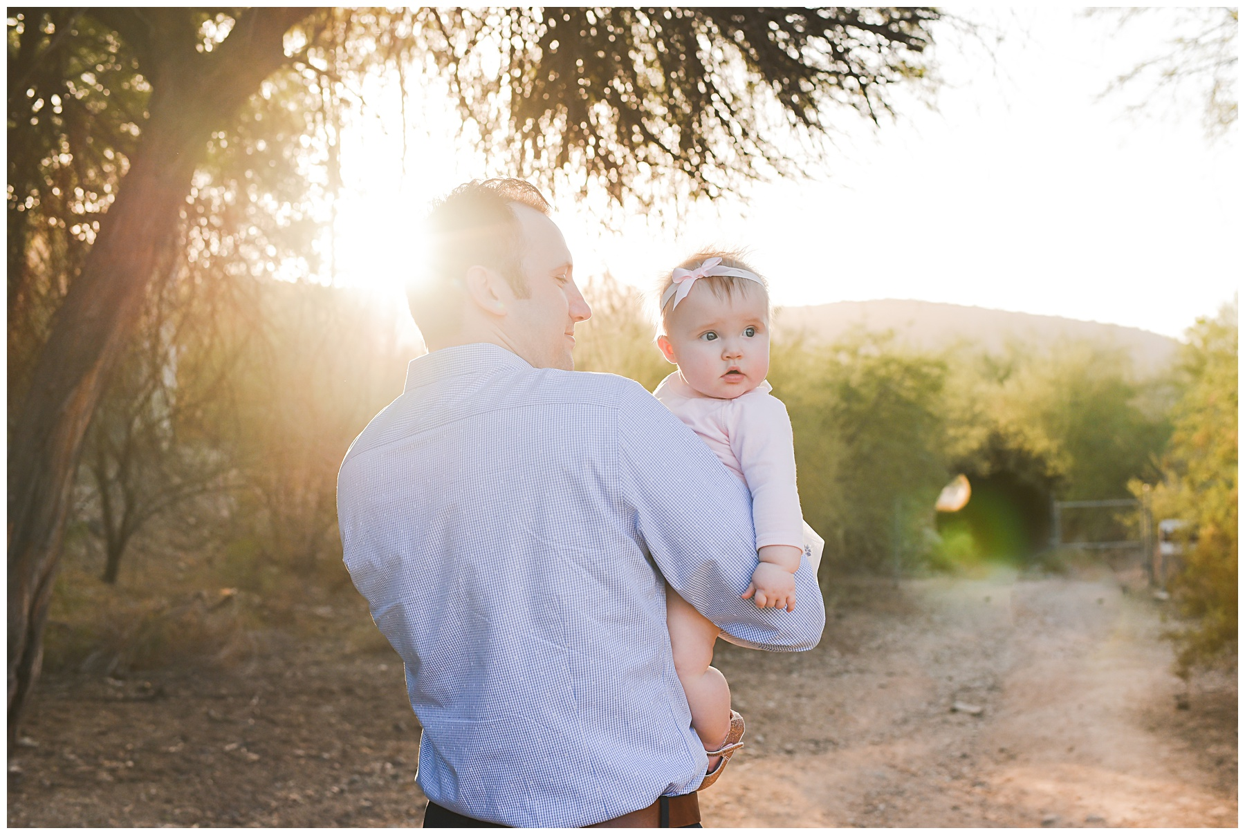 Daddy with baby girl over his shoulder | Sweetlife Photography