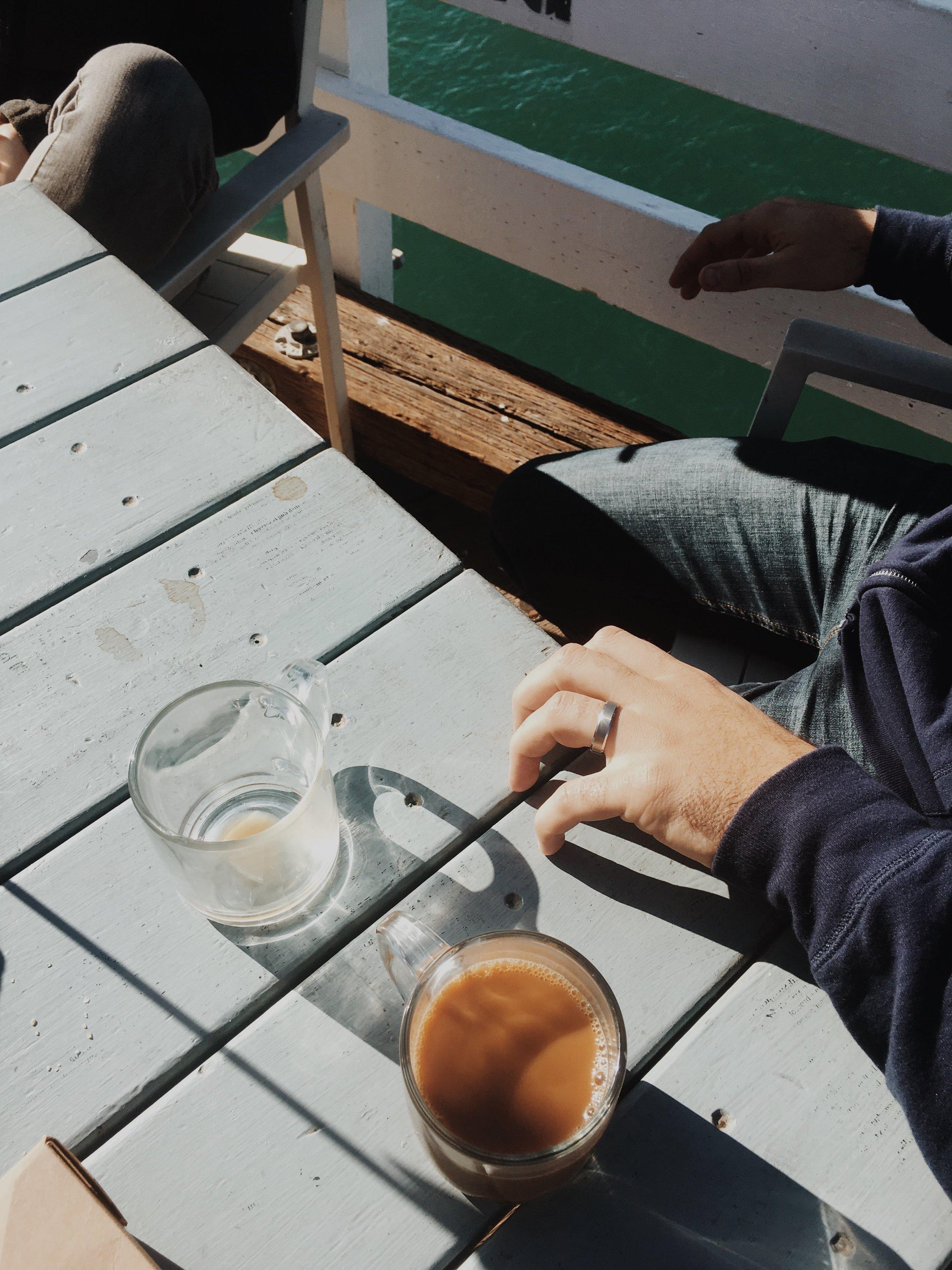Drinking multiple cups of coffee on the deck of Malibu Farm restaurant.