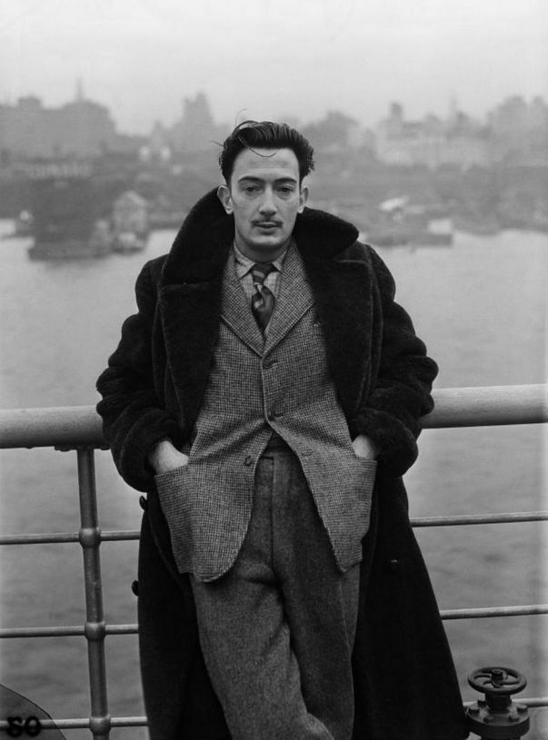 Salvador Dali stands on the deck of the S.S. Normandie in New York City, December 7, 1936. Via  Mason & Sons