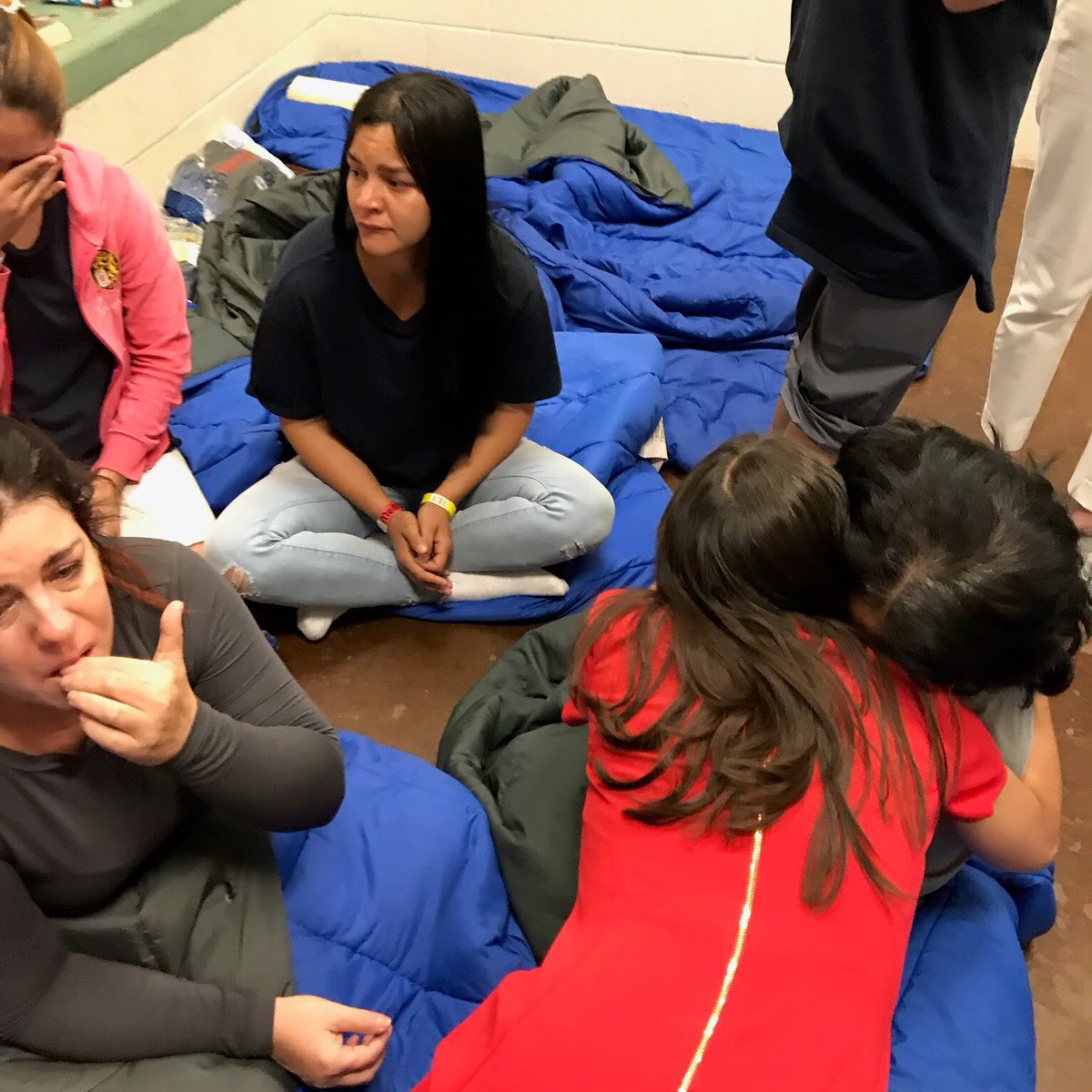 Another photo, taken by Rep. Castro and posted by Rep. Ocasio-Cortez, of women in one detention facility. Rep. Ocasio-Cortez is embracing one of the women in the lower-right corner of the photo.