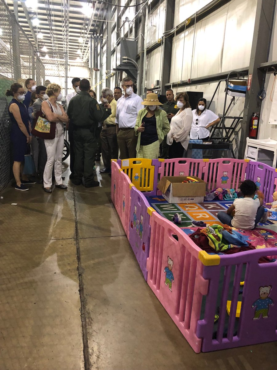A colorful play area sits against the warehouse wall of the Ursula detention center. (Photo credit: Rep. Jackie Speier)
