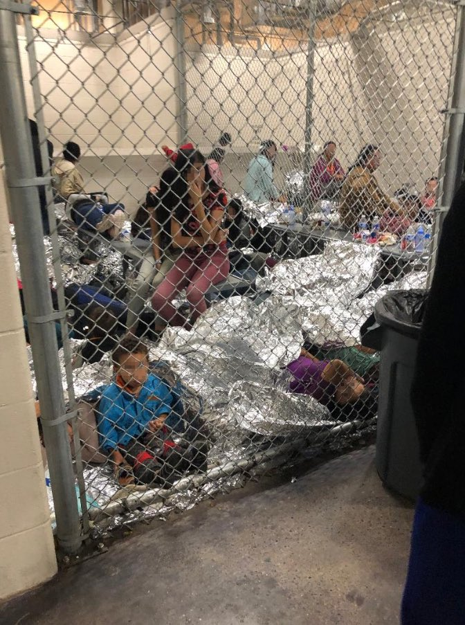 A cage containing a number of detained people, including children, and numerous Mylar blankets. (Photo credit: Rep. Jackie Speier)
