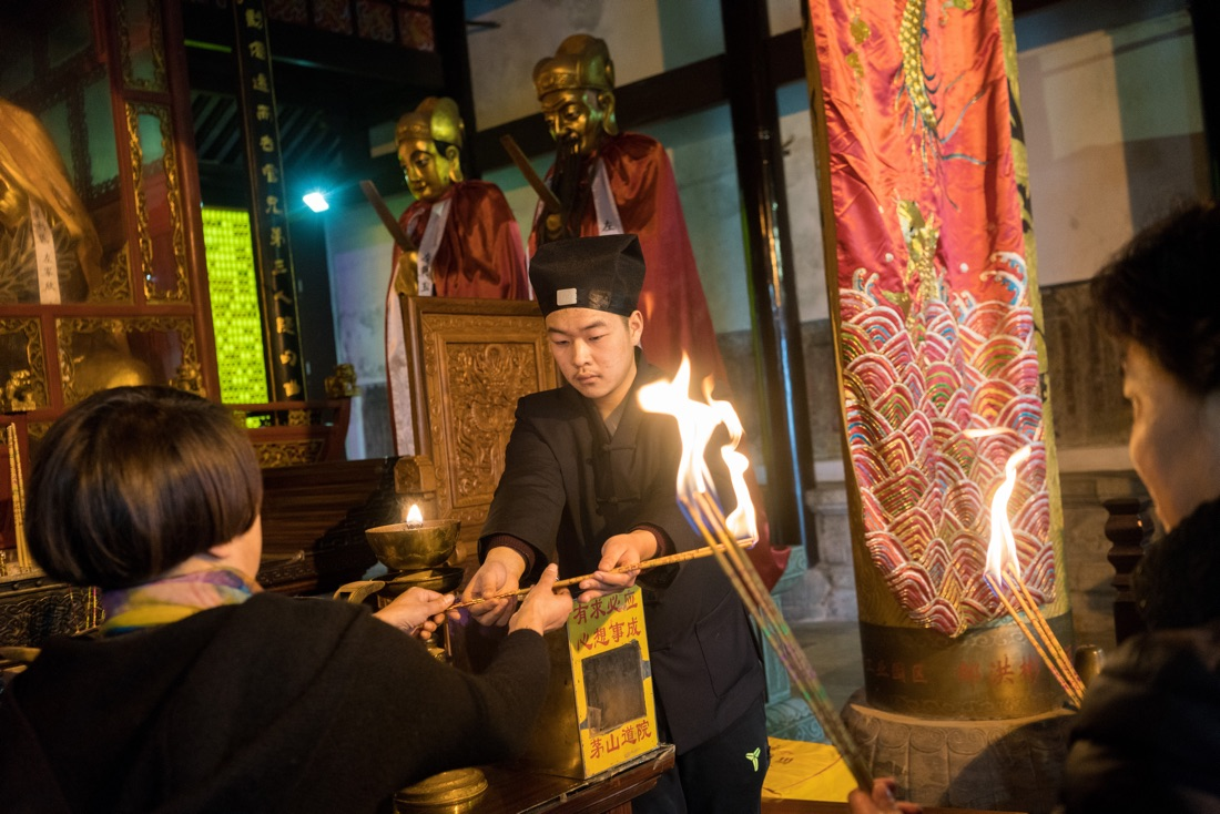 January 10, 2017 - Jurong,  Jiangsu (China). Devotess burn incense sticks inside the Jiuxiao Wanfu Gong Temple built on the top of Maoshan Mountain. © Thomas Cristofoletti / Ruom for Sixthtone