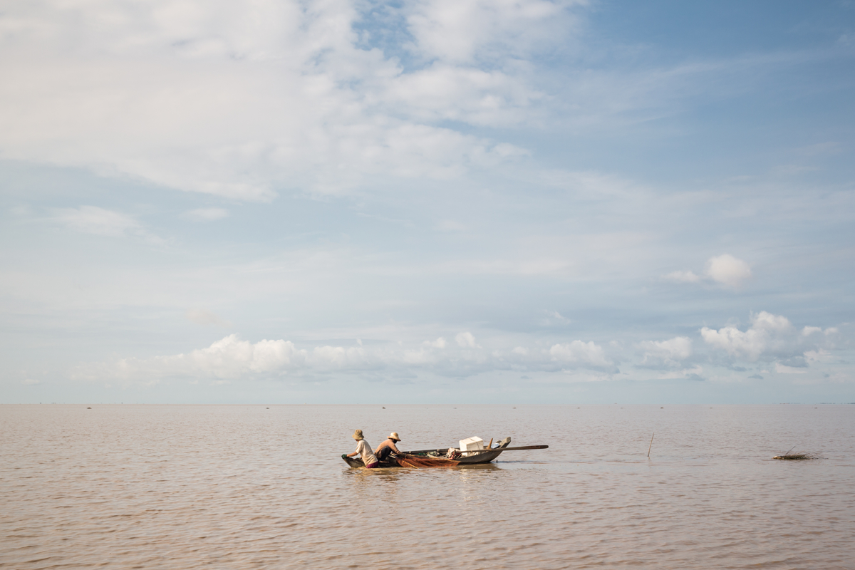 May 24, 2016 - Prek Toal, Cambodia. A couple fish on the Tonle Sap lake, the unusually low water levels on the lake means that the lake is often not much deeper than waist height. Tonle Sap lake listed as a Unesco biosphere reserve since 1997 the wetland supports the livelihoods of more than 1.2 million people and is a source of more than a third of all the protein eaten by Cambodia's 15 million people. © Nicolas Axelrod / Ruom