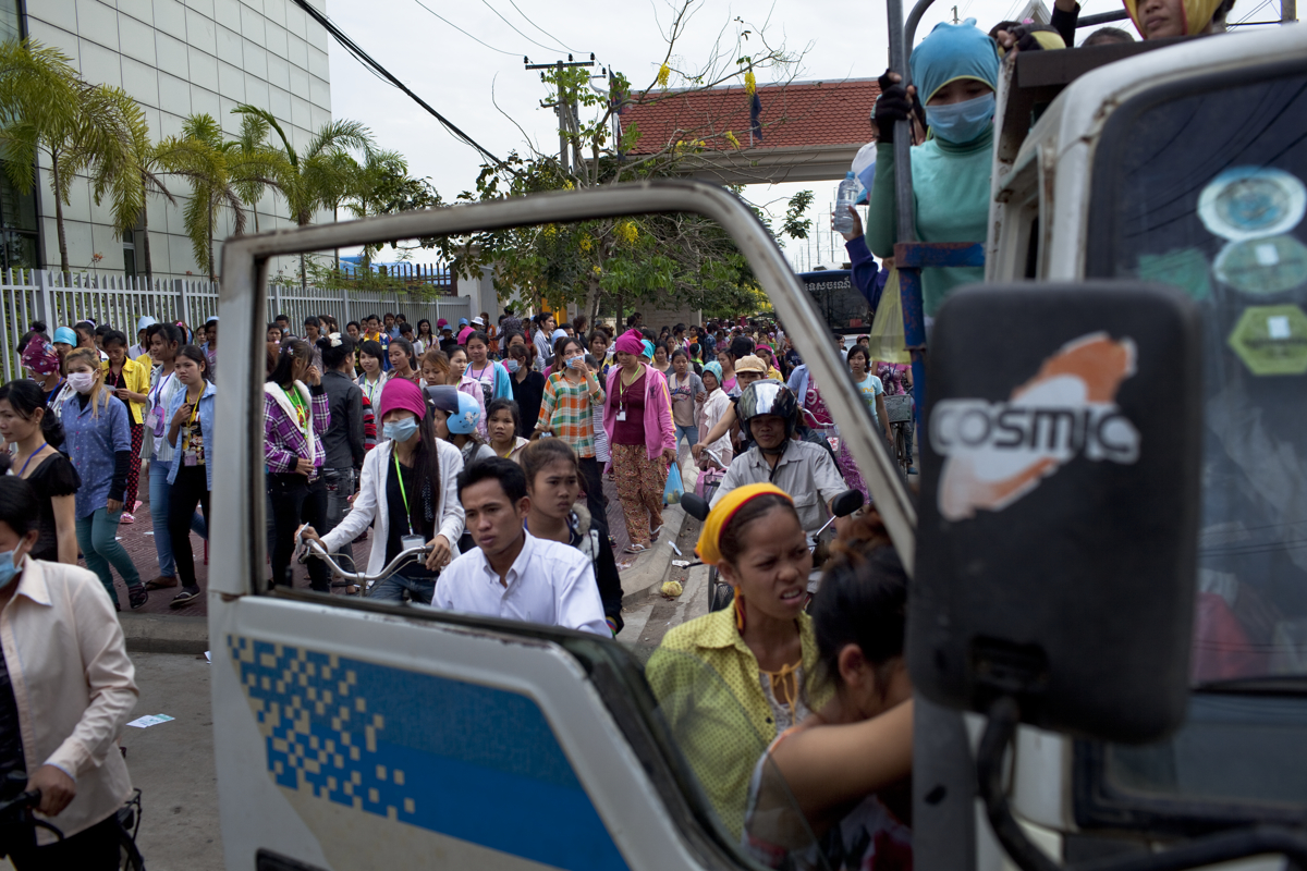 March 31, 2012 - Phnom Penh, Cambodia. Garment factory workers leave work in the evening. The garment industry is Cambodia's main export, and a source of employment for more than 800,000 people. © Nicolas Axelrod / Ruom