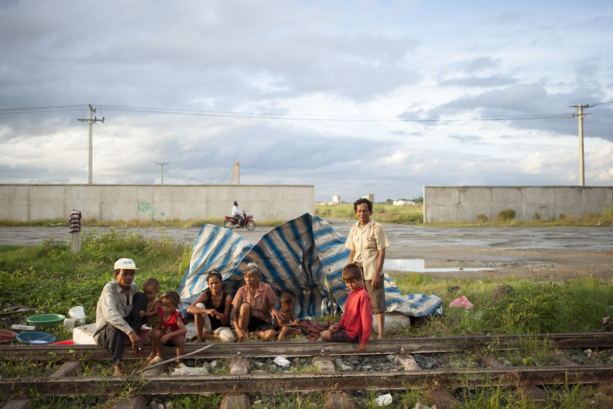 Sept. 18, 2012 - Phnom Penh, Cambodia. A family poses for a portrait, they live on the train tracks along what was once Boeung Kak lake. © Nicolas Axelrod / Ruom