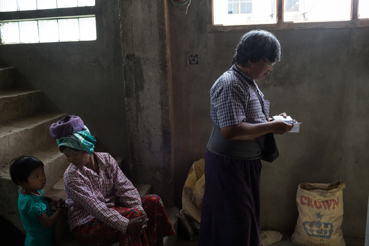 Sept. 21, 2015 - Mandalay, Myanmar. Buddhist workers in a construction site run by muslim businessman U Wai Lin. U Wai Lin has 50 staff working under him, the majority of whom are Buddhist, he equally builds homes for Muslims, Hindus, Christians and Buddhists alike. Under the pressure of anti-Muslim Monk U Wirathu and the Ma Ba Tha (previously 969) Myanmar passed four laws known collectively as the �Race and Religion Protection Laws�. The new regulations and subsequent segregation imposed by law and inflamed by the Ma Ba Tha have created an atmosphere of tension amongst Buddhists and Muslims. Mandalay is the headquarters of Wirathu and the Ma Ba Tha, and is equally home to a large community of Burmese Muslims. © Nicolas Axelrod / Ruom