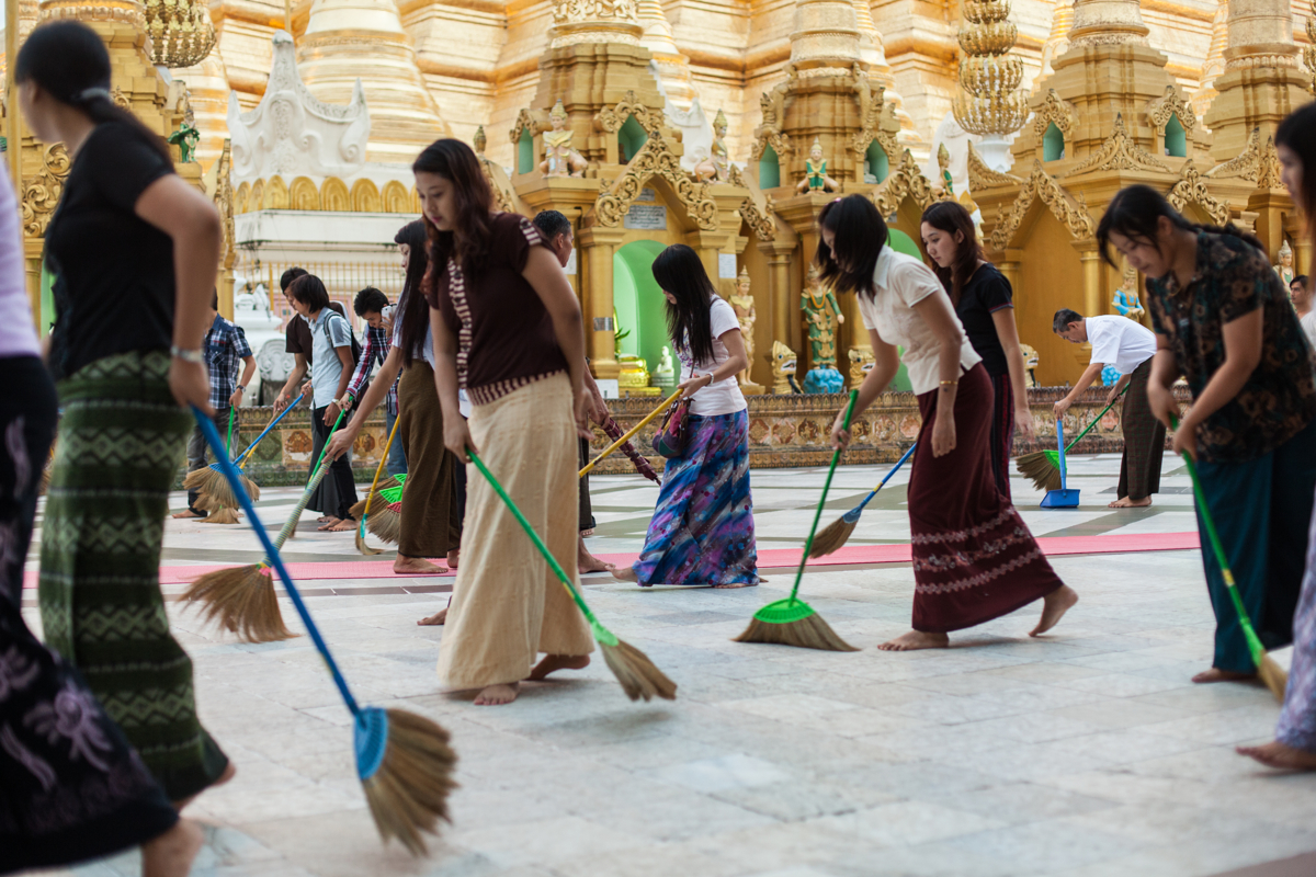 June 22, 2013 - Yangon, Myanmar. Women gather at Shwedagon Pagoda to manage the grounds as a form of seeking merit. © Nicolas Axelrod / Ruom
