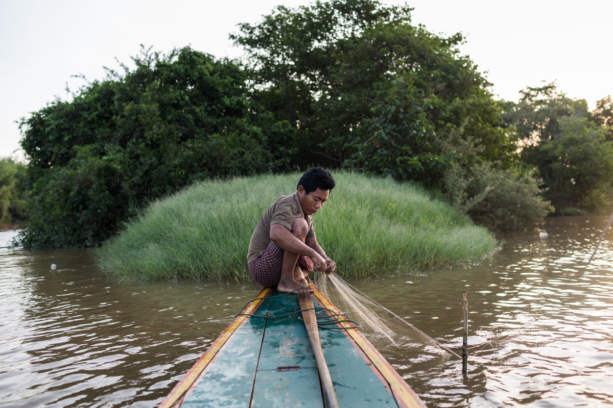 May 26, 2015 - Srekor, Cambodia. Sally Soun fishes in the early morning hours on the Sesan river. This area, and Soun's village are now flooded by the reservoir of the Lower Sesan 2 Dam. © Nicolas Axelrod / Ruom for Oxfam.