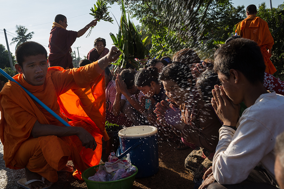 December 04, 2013 - Kampong Thom, Cambodia Monks give blessings on day four of the Human Rights Day march into Phnom Penh on National Road 6. © Nicolas Axelrod / Ruom 2013