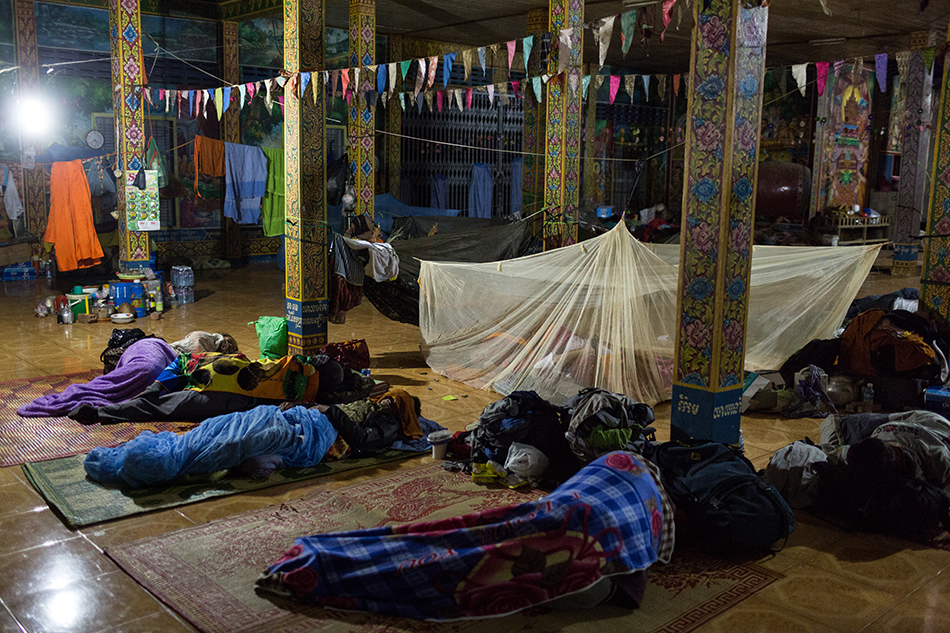 December 04, 2013 - Kampong Thom, Cambodia Community members and Monks sleep after day three of the Human Rights Day march into Phnom Penh on National Road 6. © Nicolas Axelrod / Ruom 2013